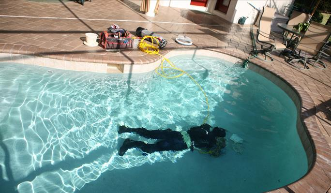 ALD technician searching for leak inside of pool